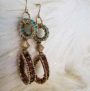 Brown and turquoise colored dangling earrings